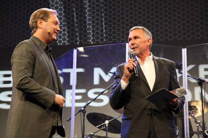 Tom Schmitt receives an award from host Steve Wariner