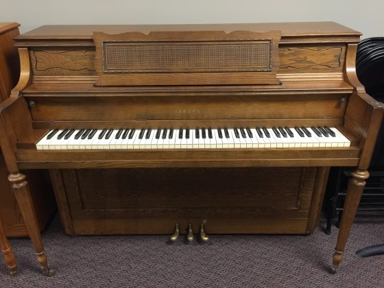 Used yamaha oak console piano schmitt music for Yamaha console piano prices