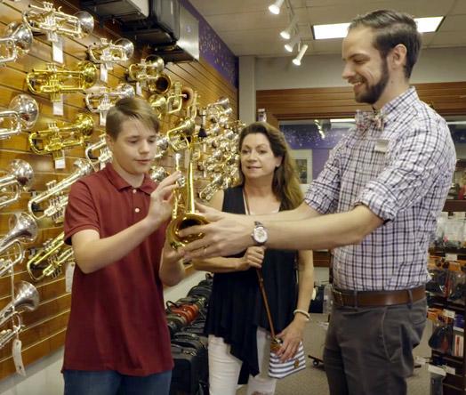 Trumpet specialist Ben helping customer