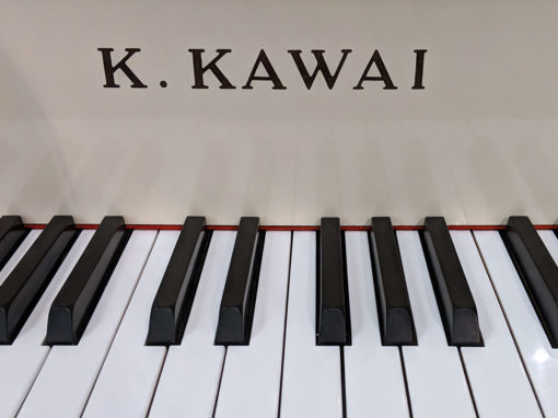"Used Kawai KG-2E 5'10"" Ivory Polish Grand Piano"